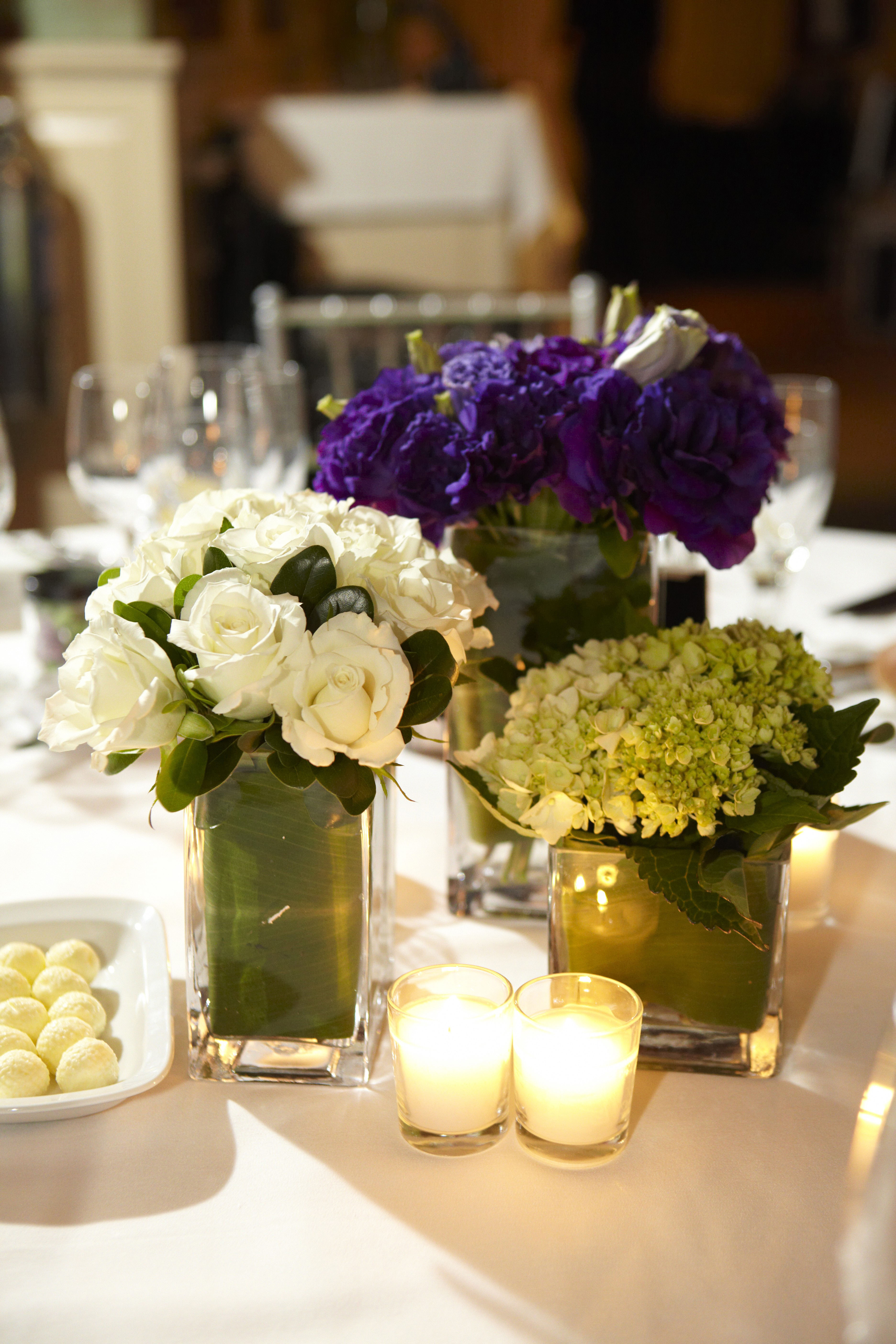 White purple and green low centerpieces weddingbee