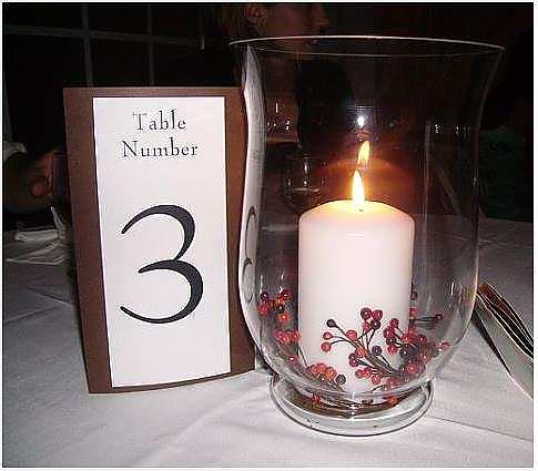 Nonfloral hurricane vase and candle centerpiece
