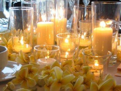 Mrs. Lemon's plumeria, glass, and candle centerpieces - yellow
