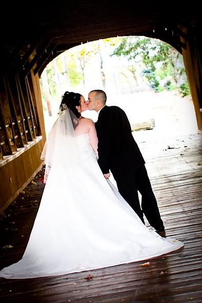 kissing on a covered bridge