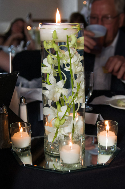 Floating candle submerged orchid centerpieces weddingbee